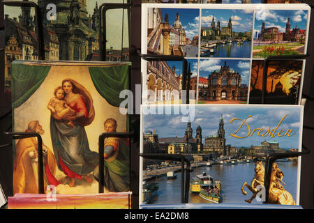 Sistine Madonna by Raphael and postcards with Dresden landmarks in a souvenir shop in Dresden, Saxony, Germany. - Stock Photo