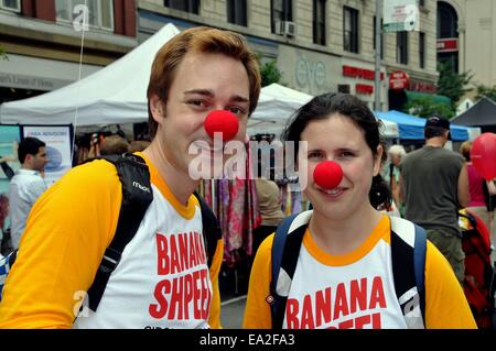 NYC:  Performers sporting red clown noses promote Cirque du Soleil's BANANA SHPEEL show at an Upper West Side street - Stock Photo