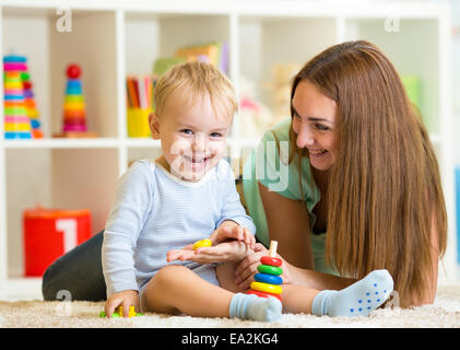 happy mother and child son play together indoor at home - Stock Photo