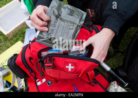 EMT personnel preparing first aid kit - USA - Stock Photo