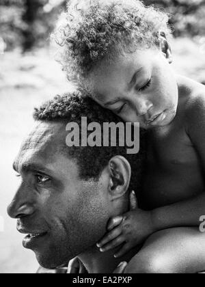 Young ni-Vanuatu girl falls asleep while being carried on her father's shoulders - Stock Photo