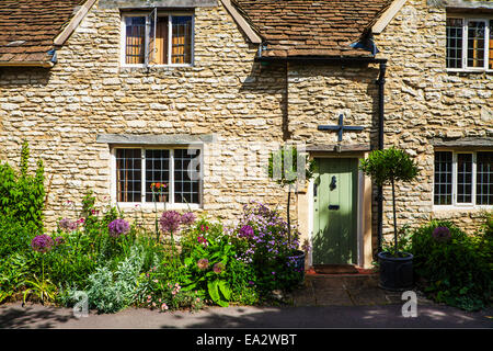 A pretty stone cottage in the Cotswold village of Castle Combe  in Wiltshire. - Stock Photo