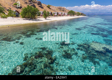 Komodo Diving Resort outdoor bungalows on Sebayur Island, Komodo Island National Park, Indonesia, Southeast Asia, - Stock Photo