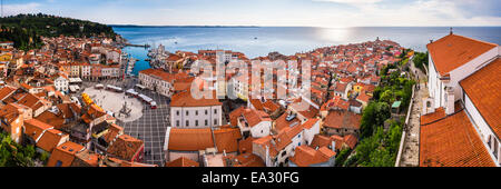 Tartini Square on left and Church of St. George on right, Piran, Primorska, Slovenian Istria,  Slovenia - Stock Photo