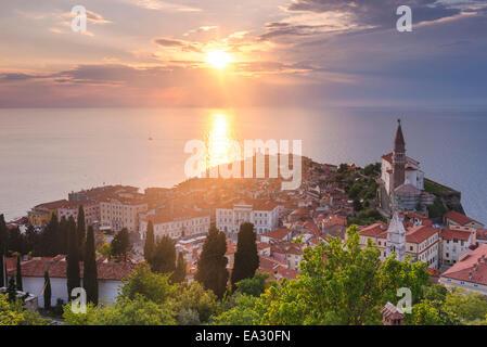 Piran at sunset, and the Mediterranean Sea, seen from Piran Town Walls, Piran, Primorska, Slovenian Istria, Slovenia, - Stock Photo