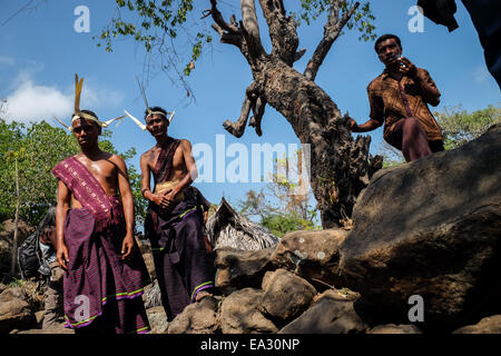 Local people in traditional costumes at Lamagute village, Lembata Island, Indonesia. - Stock Photo