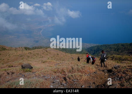 Mountaineering activity atop Ile (Mount Lewotolok), Lembata Island, East Nusa Tenggara, Indonesia. - Stock Photo
