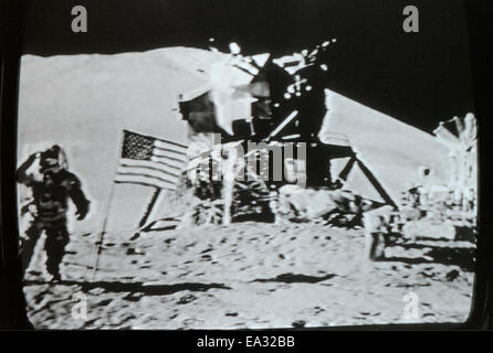 Moon landing lunar module Eagle, flag and astronaut 20 July 1969 photographed in actual real time on television - Stock Photo
