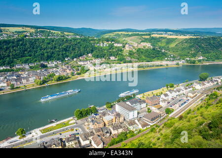 Cruise ship passes St. Goarshausen on the River Rhine, Rhine Gorge, UNESCO World Heritage Site, Germany, Europe - Stock Photo