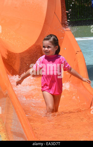 Child (girl age 04) play with water in water park.Concept photo with copy space - Stock Photo
