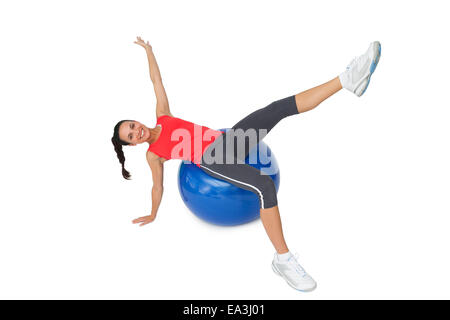 Fit young woman stretching on exercise ball - Stock Photo