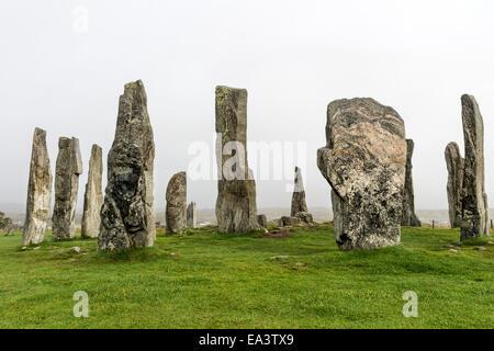 Mist Sweeping Over the Callanish Standing Stones, Isle of Lewis Hebrides Scotland UK - Stock Photo