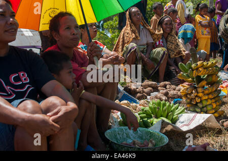Women with their vegetables and fruits to trade at the barter market of Wulandoni village, Lembata Island, Indonesia. - Stock Photo