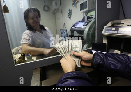 Moscow, Russia. 6th Nov, 2014. An employee of a currency exchange office. Credit:  Pavel Smertin/TASS/Alamy Live - Stock Photo