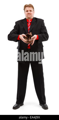 Poor man showing his empty wallet. Financial crisis concept, people left without money, zero buying power - Stock Photo