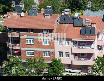 solar panels on roofs of apartment blocks, Niksar town, Anatolia, Turley - Stock Photo