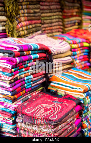 Fabrics on the market in Fes, Morocco - Stock Photo