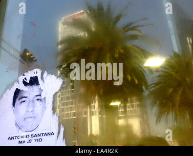 Mexico city, Mexico. 6th November, 2014. A portrait of missing student Antonio Santana is displayed  in Reforma - Stock Photo
