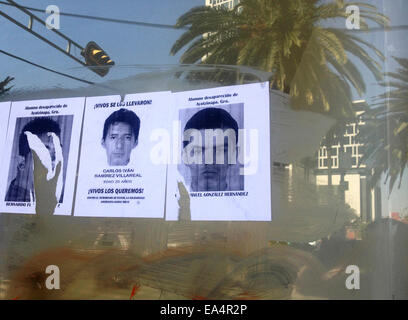 Mexico city, Mexico. 6th November, 2014. Portraits of missing students are displayed in Reforma Avenue in Mexico - Stock Photo