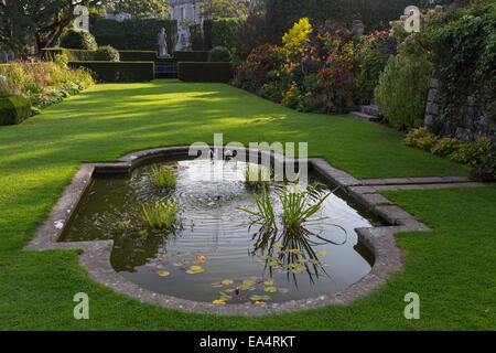 Late afternoon light over the landscaped grounds of Plas Newydd Country House and Gardens, Anglesey, North Wales, - Stock Photo