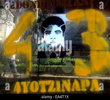 Mexico city, Mexico. 6th November, 2014. A graffiti with the face of a missing student is displayed in Reforma Avenue - Stock Photo