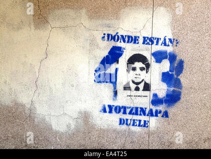Mexico city, Mexico. 6th November, 2014. A portrait of missing student Antonio Santana is displayed in Reforma Avenue - Stock Photo