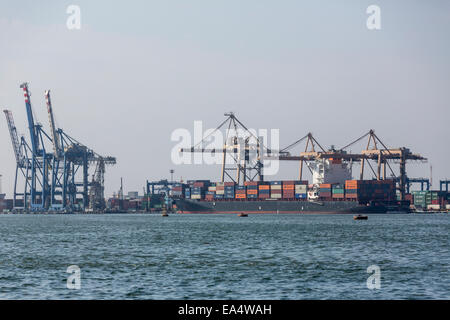 container ship and cranes at Port Said, Egypt - Stock Photo