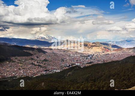 The city of La Paz with Illimani rising in the distance, the highest peak in Bolivia; La Paz, Bolivia - Stock Photo