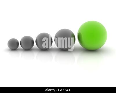 a green sphere placed observably with four gray spheres. - Stock Photo