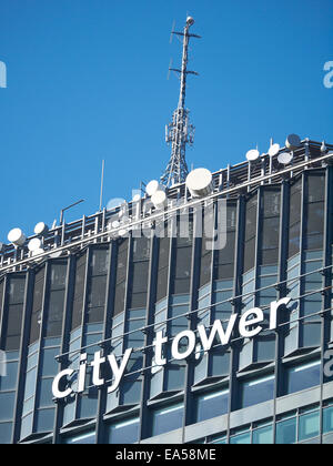 Architectural detail of City Tower with communication equipment in Manchester UK - Stock Photo