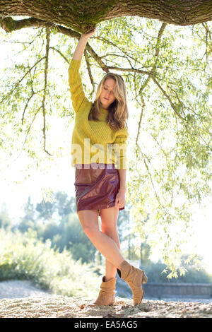 Young woman wearing knit pullover and mini skirt - Stock Photo
