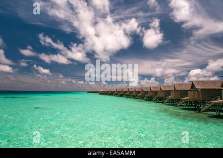 Water villas  on the  tropical island, Maldives - Stock Photo