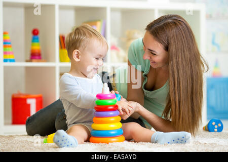 cute mother and child boy play together indoor at home - Stock Photo