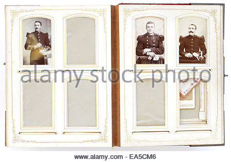 open vintage photo album from late 1800s with portraits and missing photographs - Stock Photo