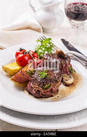 deer meat meddallions - Stock Photo