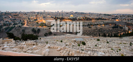 The temple mount and the graves from the mount of olives in front in the twilight in Jerusalem - Stock Photo