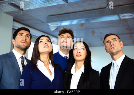 Business people looking up with dreaming expression - Stock Photo