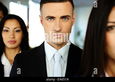 Group of a young businesspeople standing in a row - Stock Photo