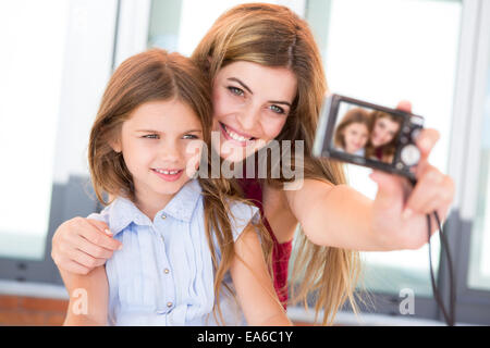 Girl taking a selfie with her mother or sister - Stock Photo