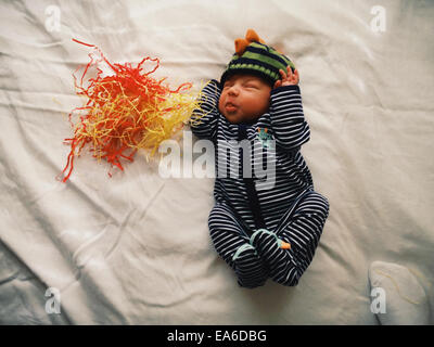 Baby boy making faces - Stock Photo
