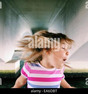 USA, Florida, Palm Beach County, West Palm Beach, Girl (2-3) shaking head - Stock Photo