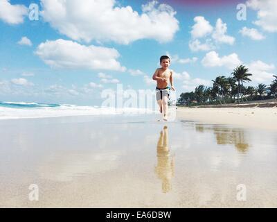 USA, Florida, Palm Beach County, West Palm Beach, Boy (2-3) running on beach - Stock Photo