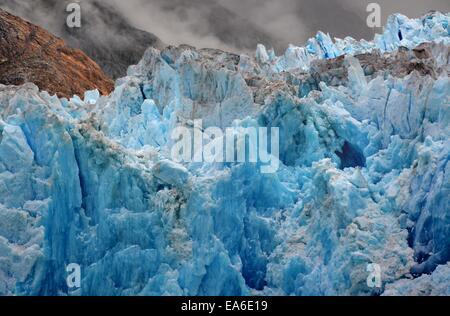 USA, Alaska, Tongass National Forest near Juneau, Blue ice of South Sawyer Glacier - Stock Photo
