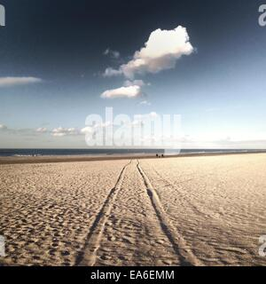 Tire tracks on beach - Stock Photo