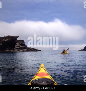Spain, Costa Brava, Kayaking among cliffs - Stock Photo