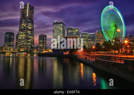 Japan, Kanagawa Prefecture, Yokohama, Illuminated cityscape with Ferris wheel - Stock Photo