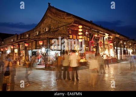 China, Pingyao, Busy night market along Pingyao street - Stock Photo