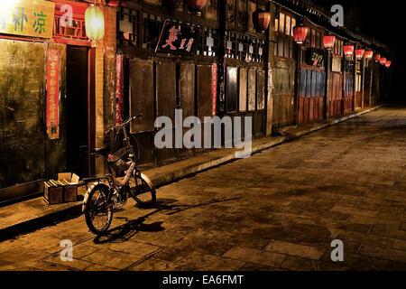 China, Pingyao, Street along the Pinyao market at night time - Stock Photo