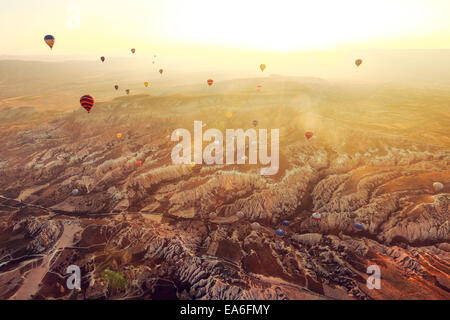 Hot air balloons flying over Cappadocia, Turkey - Stock Photo