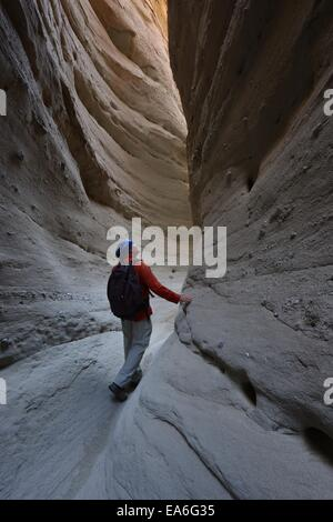 USA, California, Anza-Borrego Desert State Park, Man hiking through Palm Slot Canyon - Stock Photo
